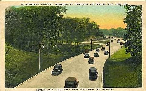 This postcard from around 1940 shows the Jackie Robinson Parkway -- then known as the Interborough Parkway -- through Forest Park. Note the undivided four-lane design and timber lightposts. (Postcard published by The Albertype Co., Brooklyn, NY; from oldkewgardens.com.)